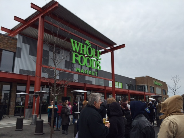 Crowds gather outside the Whole Foods