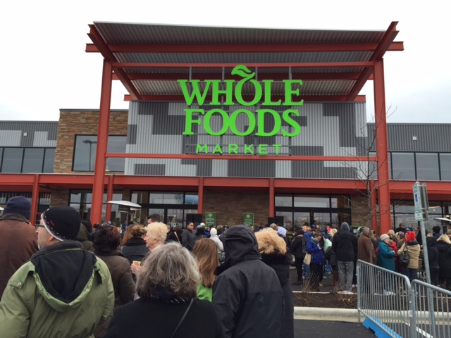 """Shoppers watch the Whole Foods """"bread breaking"""" ceremony"""