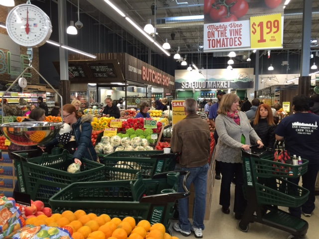 Visitors eagerly shop the produce section