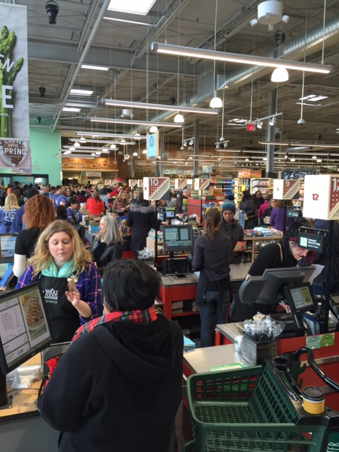 WFM team members ringing up purchases